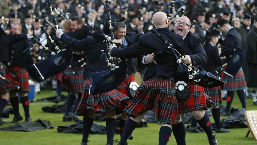 SKOTTER: Skotske sekkepipespillere i det årlige World Pipe Band Championships i Glasgow. Foto: REUTERS / Russell Cheyne / NTB scanpix