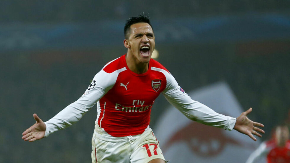 Arsenal's Alexis Sanchez celebrates after scoring a goal against Borussia Dortmund during their Champions League group D soccer match in London November 26, 2014.        REUTERS/Eddie Keogh (BRITAIN  - Tags: SPORT SOCCER)