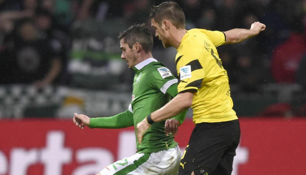I TRØBBEL:  Sebastian Kehl og Dortmund tapte mot  Werder Bremen i dag. Foto: NTB Scanpix