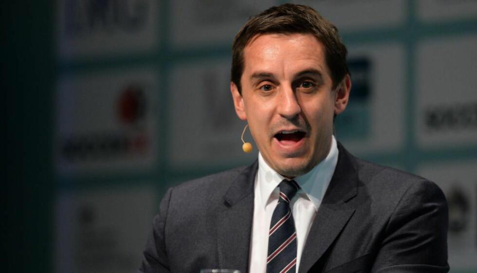 UT MOT GAMLEKLUBBEN:  Gary Neville går hardt ut mot Manchester Uniteds overgangspolitikk. Foto: AFP PHOTO/ANDREW YATES