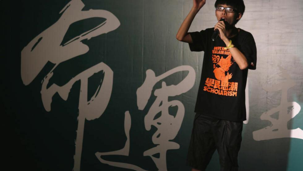 SATTE FYR PÅ BYEN:  Joshua Wong leder Scholarism som gikk i bresjen for protestene i Hongkong. Foto: REUTERS/Bobby Yip