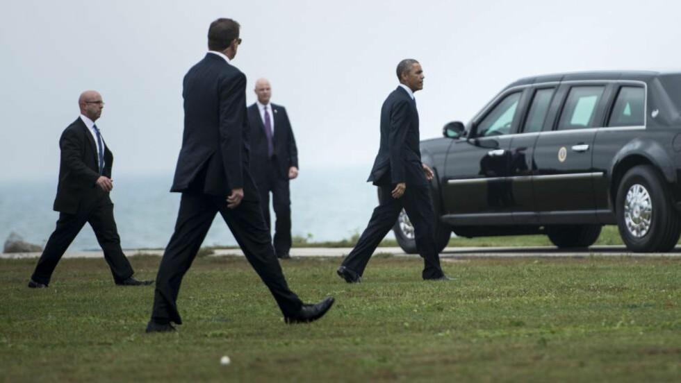 LIVVAKTER: Agenter fra Secret Service følger president Barack Obama døgnet rundt. Nå er politistyrken rammet av en rekke skandaler. Foto: BRENDAN SMIALOWSKI / AFP PHOTO