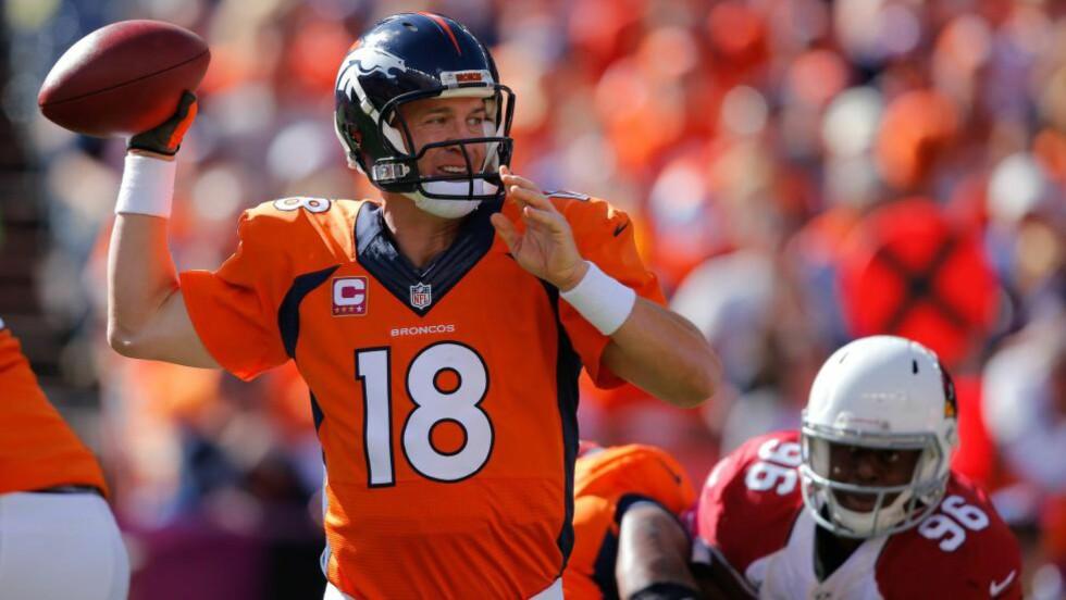 REKORD-MANN(ING): Denver Broncos quarterback Peyton Manning er bare den andre i NFL-historien som har klart 500 touchdownpasninger. Den historiske milepælen nådde han natt til mandag. Foto: Doug Pensinger / Getty Images / AFP / NTB Scanpix