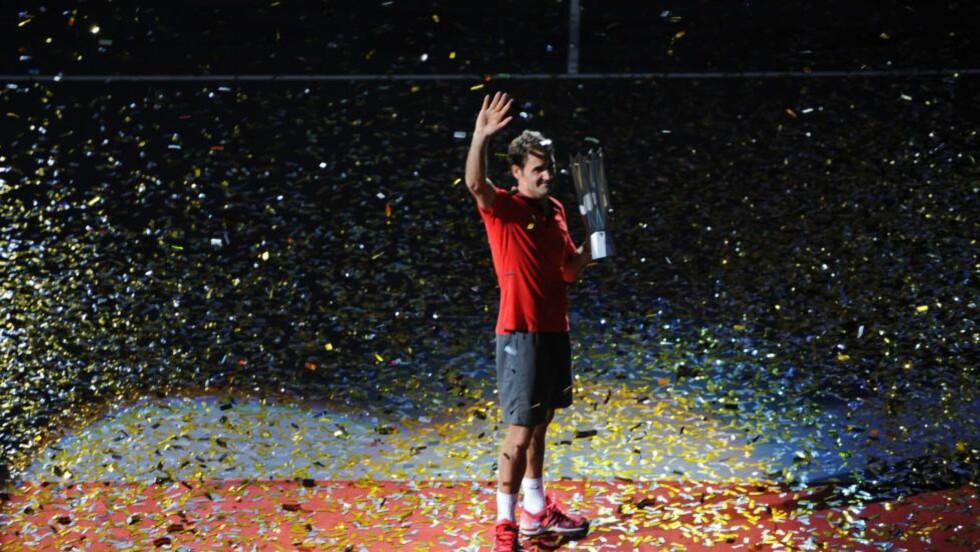 VANT I KINA: Roger Federer vant finalen i Shanghai Masters 1000 i strake sett. Foto:   AFP PHOTO/GOH CHAI HIN