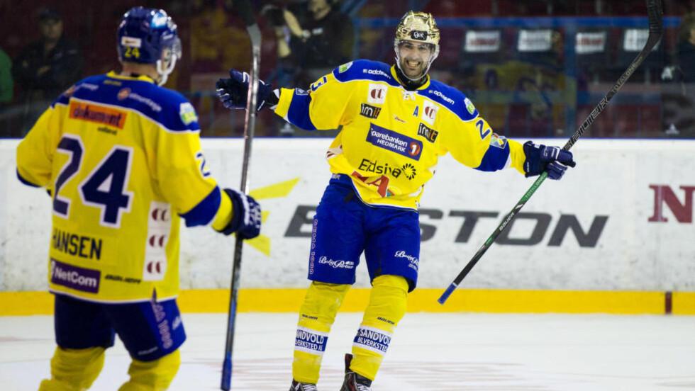 SLO ENGA:  Christian Larrivée og Storhamar har grunn til å glise. I kveld ble VIF slått på Hamar. Foto: Vegard Wivestad Grøtt / NTB scanpix
