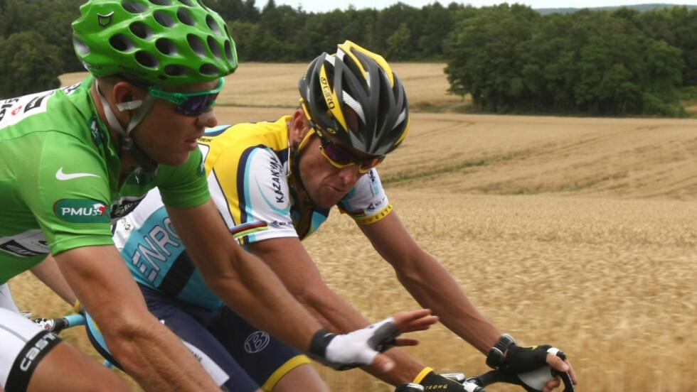 KOMPISER: Thor Hushovd og Lance Armstrong rakk å bli kompiser under sin tid i sykkelfeltet. I 2011 ble Hushovd invitert til Armstrong i USA, og der innrømmet amerikaneren doping overfor Hushovd. Foto: AFP PHOTO JOEL SAGET