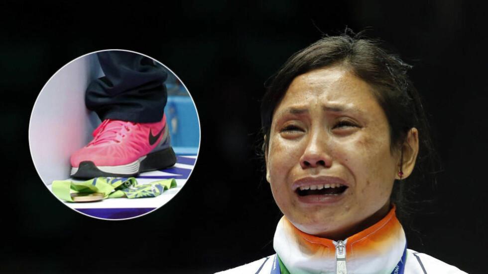 OPPLØST I TÅRER: Sarita Devi var fullstendig knust under medaljeseremonien for kvinnenes lettvektsklasse under Asialekene. Foto: NTB Scanpix