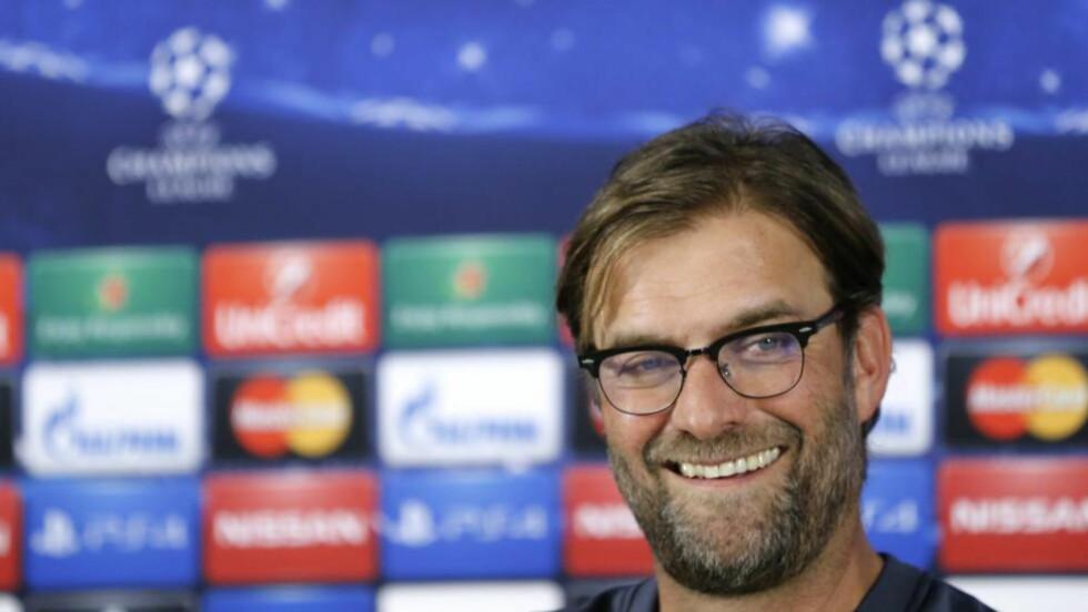 SMIL:  Jürgen Klopp og Borussia Dortmund er inne i en elendig periode. Men suksessmanageren er fredet. Foto: NTB Scanpix