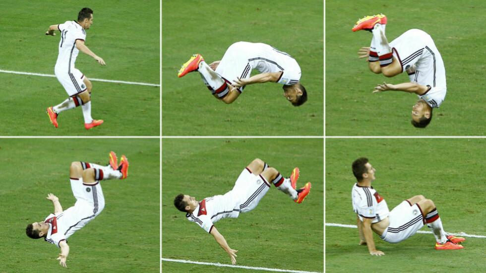 KLOSES SALTO: Tyske Miroslav Klose viste fram sine salto-egenskaper etter å ha scoret mot Ghana under sommerens fotball-VM. Nå vil FIFA forby denne typen feiring. Foto: NTB Scanpix