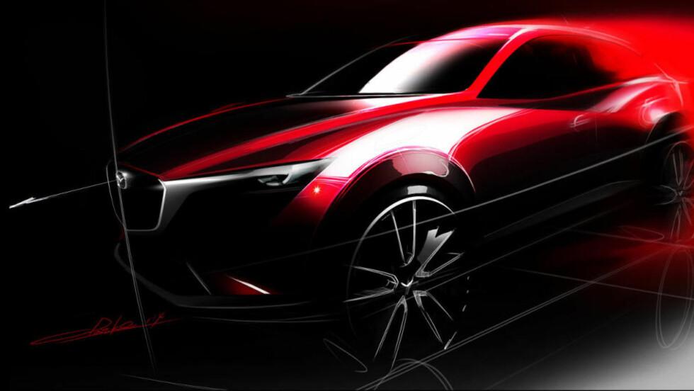 TEASER: Dette er allt vi får se av Mazda CX-3 foreløpig, men snart skal den avdukes på bilutstillingen i Los Angeles. Dette er uansett en spennende nyhet for det noorske markedet. Foto: MAZDA