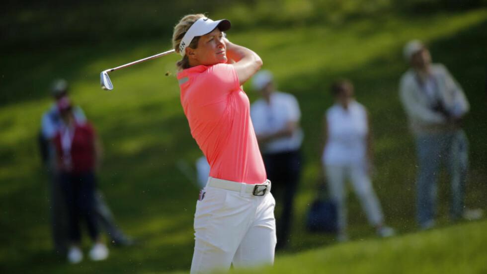 IKKE ALL VERDEN: ... til åpningsrunde for Suzann Pettersen i Taiwan. Den LPGA-turneringen har hun vunnet de siste to årene. Foto: AP Photo/Laurent Cipriani