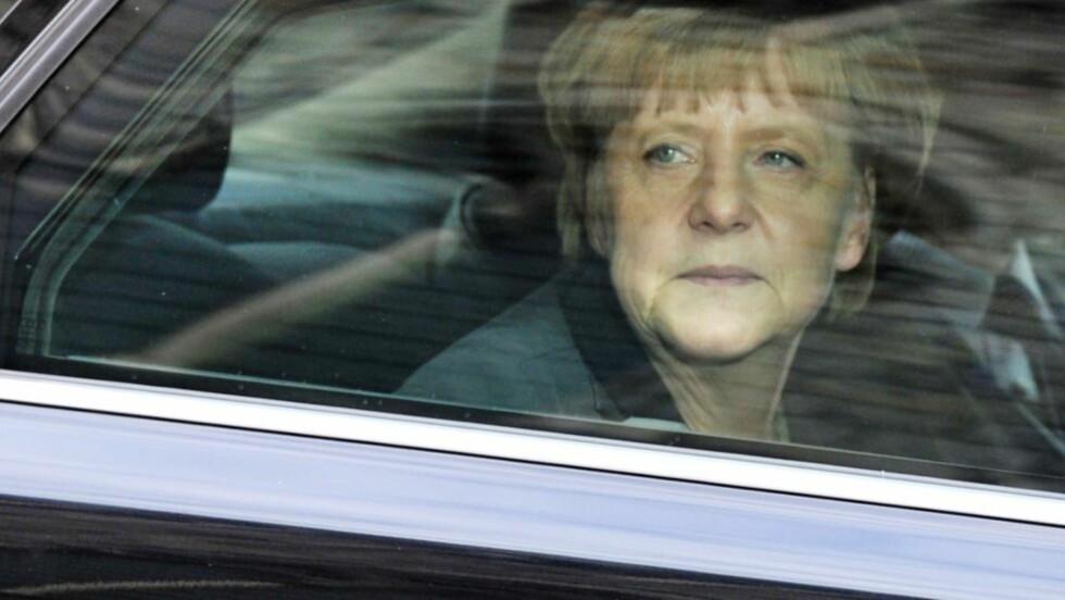 SIER STOPP Tysklands forbundskansler, Angela Merkels, mobiltelefon ble overvåket av amerikanerne. Nå har Tyskland brutt en kontakt med det amerikanske teleselskapet Verizon. Foto: AFP PHOTO / GEORGES GOBET