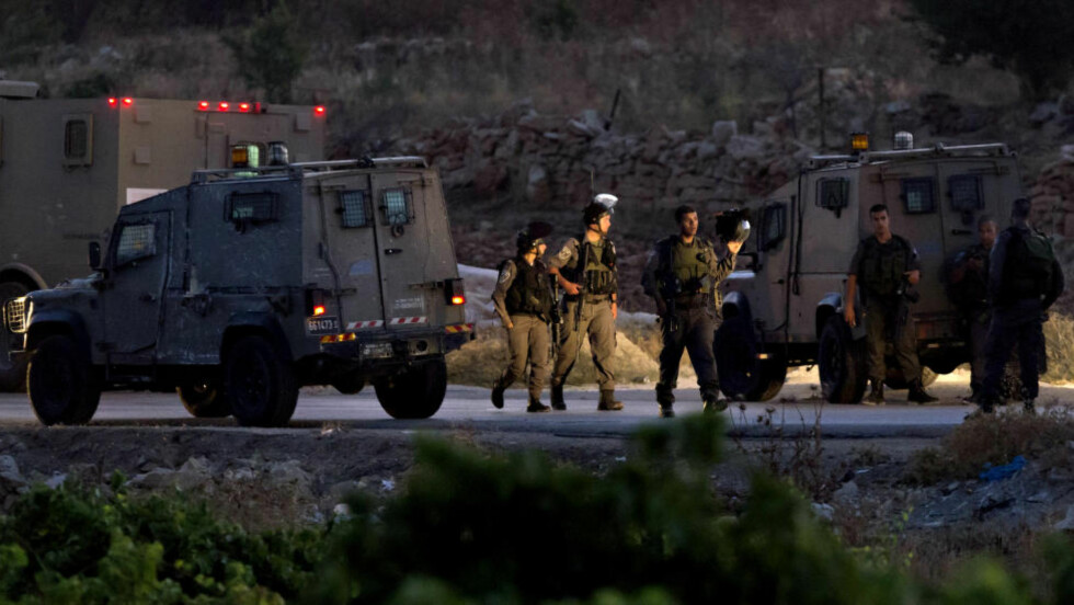 BESKYLDER HAMAS: Israelske styrker fant i kveld kroppene til de tre savnede tenåringene ved landsbyen Halhul nord for Hebron. De tre tenåringene hadde vært savnet siden 12. juni. Israel har beskyldt Hamas for å stå bak bortføringene. Foto: EPA/Jim Hollander/NTB scanpix