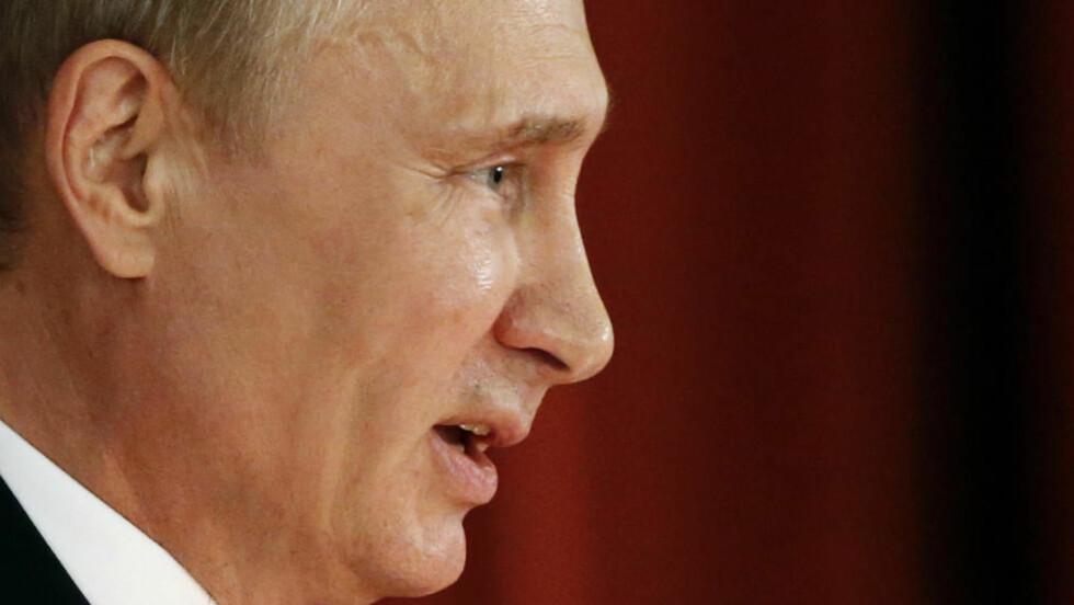 BANNE-FORBUD: Putin har fått kritikk for en ny lov mot banning. Aktivister mener loven minner om sensuren i Sovjetunionen. Foto: Reuters / NTB scanpix
