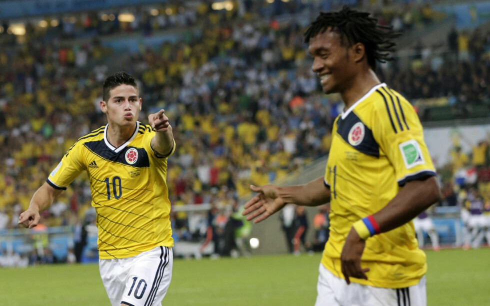 HERJER: James Rogdriguez og Juan Cuadrado har herjet med samtlige forsvar de har møtt så langt i VM. I kveld venter vertsnasjonen Brasil i Fortaleza. Foto: AP Photo/Marcio Jose Sanchez/NTB Scanpix