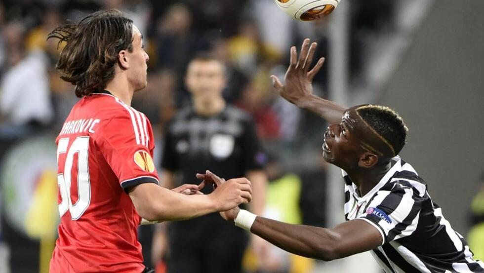 PÅ FLYTTEFOT?: Lazar Markovic (t.v.) kobles til Liverpool, mens Paul Pogba (t.h.) skal være Chelsea-aktuell. Foto: AFP PHOTO / OLIVIER MORIN / NTB Scanpix
