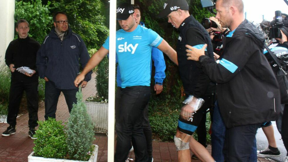 Britain's Christopher Froome injured arrives at his hotel in Marcq-en-Bar ul on July 9, 2014. Defending champion Chris Froome crashed out of the Tour de France today after falling twice on a wet and treacherous 152,5 km fifth stage of the 101st edition of the Tour de France cycling race between Ypres, northwestern Belgium, and Arenberg Porte du Hainaut in Wallers northern France.  AFP PHOTO / JACQUES RADIX