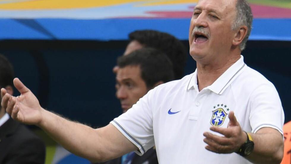 SAGT OPP: Brasils landslagssjef Luiz Felipe Scolari har sagt opp jobben som Brasils landslagssjef etter VM-fiaskoen på hjemmebane, melder avisen Globo. Foto:  AFP PHOTO / FABRICE COFFRINI