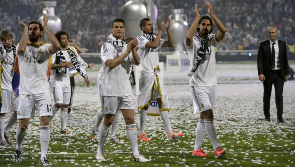 PÅ TOPP: Cristiano Ronaldo gjorde et skuffende VM, men hans klubb Real Madrid rangeres fortsatt som verdens mest verdifulle idrettsklubb. Her etter finaleseieren i Champions League. Foto: NTB Scanpix