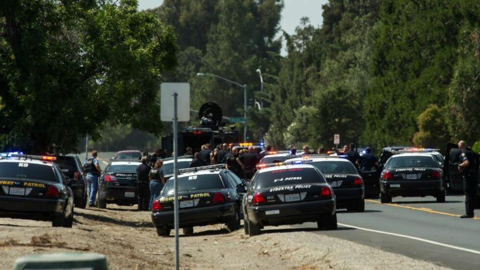 TRE DØDE: To ranere og en kvinnelig bankansatt døde under en politijakt i California i går. Foto: AP/Craig Sanders/Scanpix