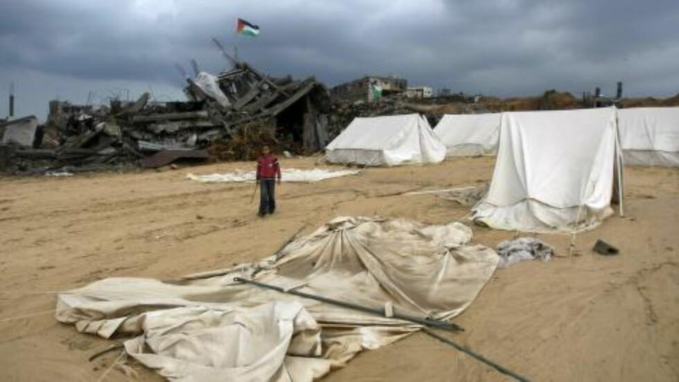 STOR KONFLIKT: Den tre uker lange Gaza-krigen i 2009 kostet mange palestinere liver. Dette bildet viser ødeleggelser i byen Jabalia, nord på Gazastripa. Foto: AFP PHOTO/MAHMUD HAMS