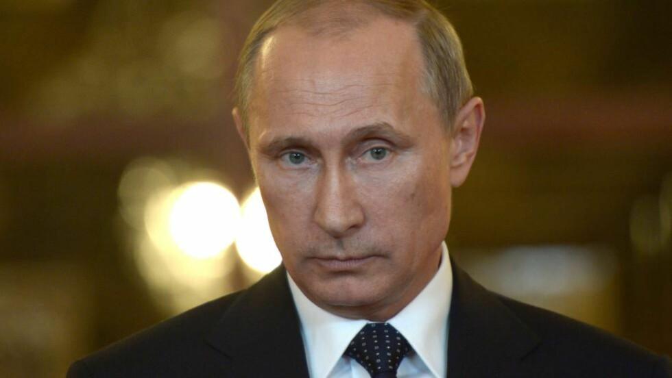 ADVARER:  Russlands president mener flytragedien ikke hadde skjedd om ikke Ukraina hadde gjenopptatt militæroperasjonene øst i landet, samtidig som han advarer alle andre mot å slå politisk mynt på tragedien. Foto: AFP PHOTO / RIA-NOVOSTI