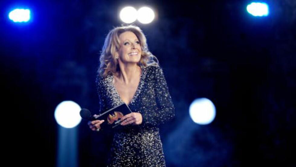 BLIR PROGRAMLEDER: Det er Marte Stokstad som skal lede NRKs nye fredagssatsning «The Hit». Her er hun under Melodi Grand Prix-finalen i 2012. Foto: Torbjørn Grønning / Dagbladet