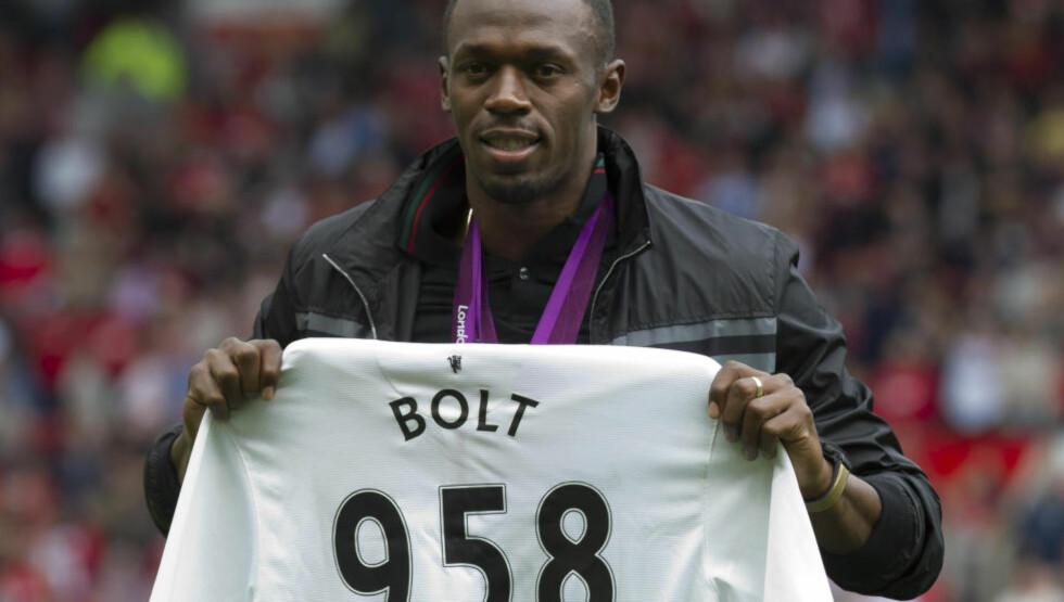 NY KARRIERE: Usain Bolt har gjort det klart at han er Manchester United-tilhenger, og fleipet med at han kunne spilt for dem. Nå ytrer han nok en gang ønsket om å forsøke seg med fotballsko på beina, men denne gangen litt mer seriøst. - Jeg vil gi det en ordentlig sjanse, sier han. Foto: AP Photo/Jon Super/NTB Scanpix