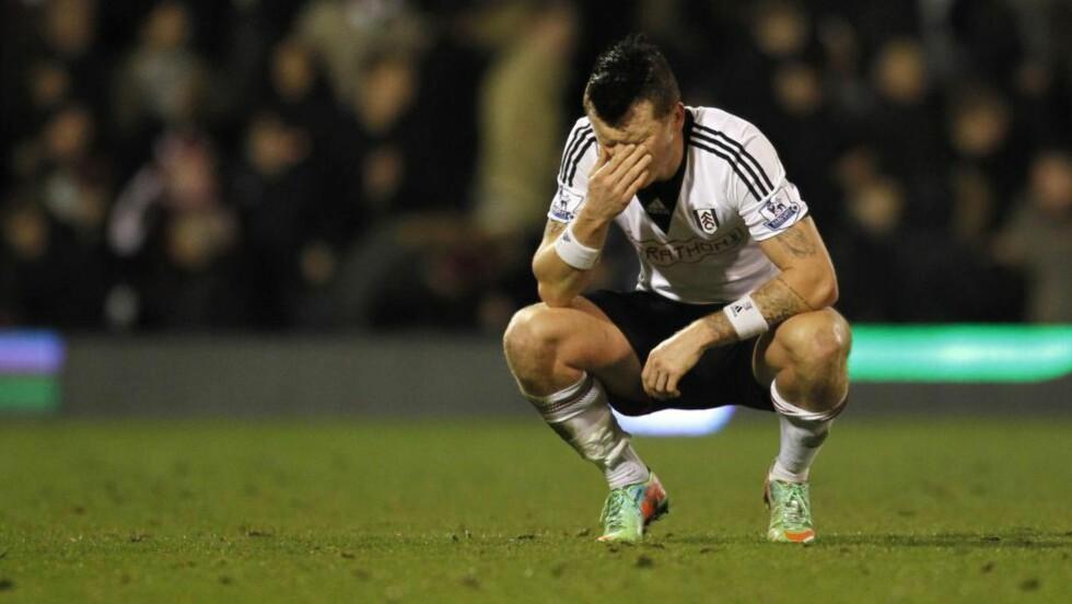 NEDTUR: John Arne Riise rykket ned fra Premier League med Fulham i vår. Hos TV2 i går kom han med sin versjon av treningene under Felix Magath. Foto: AFP  / IAN KINGTON / NTB SCANPIX