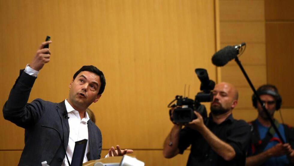 AKADEMISK SENSASJON:  Franske Thomas Pikettys fagblok om formuer, inntekt og ulikhet gikk til topps på amerikanske bestselgerlister. Boka hylles som den biktigste økonomiboka på tiår. Foto: Getty Images/AFP/NTB Scanpix