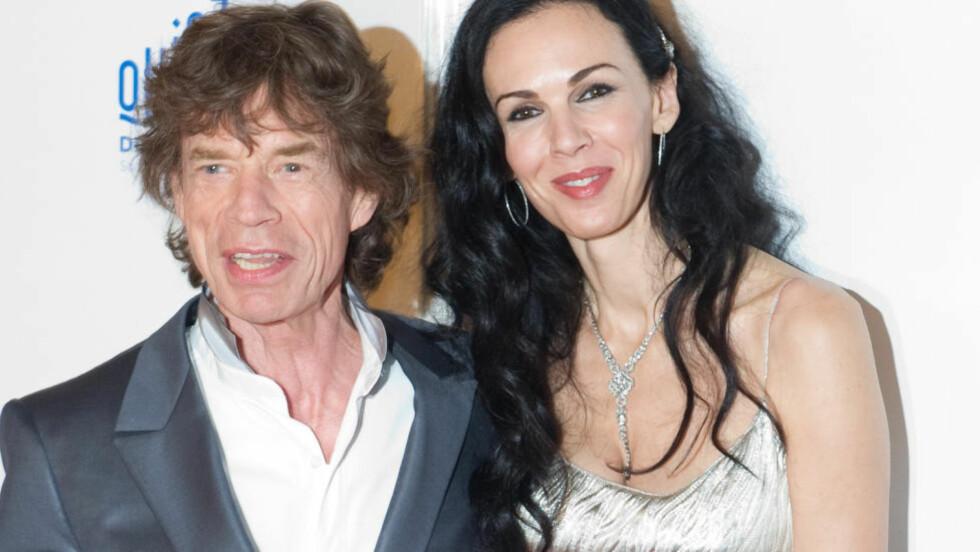 TRAGISK SLUTT:  The Rolling Stones-vokalist Mick Jagger og designer og stylist L'Wren Scott var sammen siden 2001. L'Wren Scott tok sitt eget liv i mars i år, og Jagger sang for henne under i minneseremonien i New York. AFP PHOTO / MARTIN BUREAU