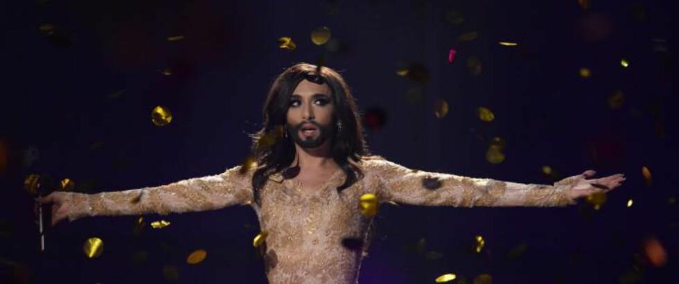 FØNIKSFUGLEN TIL HIMMELS:  Conchita Wurst har fått mye oppmerksomhet de siste ukene, og i dag trakk hun det aller lengste strået og gikk av med seieren i årets Eurovision-finale. Foto: AFP / NTB scanpix