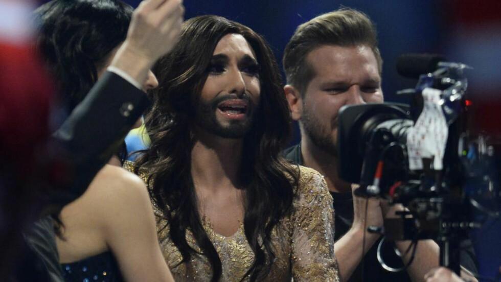 TÅREVÅT SEIER: Conchita Wurst la ikke skjul på at Eurovision-seieren betydde mye for henne. Foto: AFP / NTB scanpix
