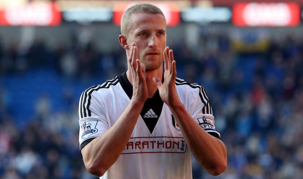 FJERNET: Fulham og Brede Hangeland  skiller lag. Foto:  AFP PHOTO / GEOFF CADDICK