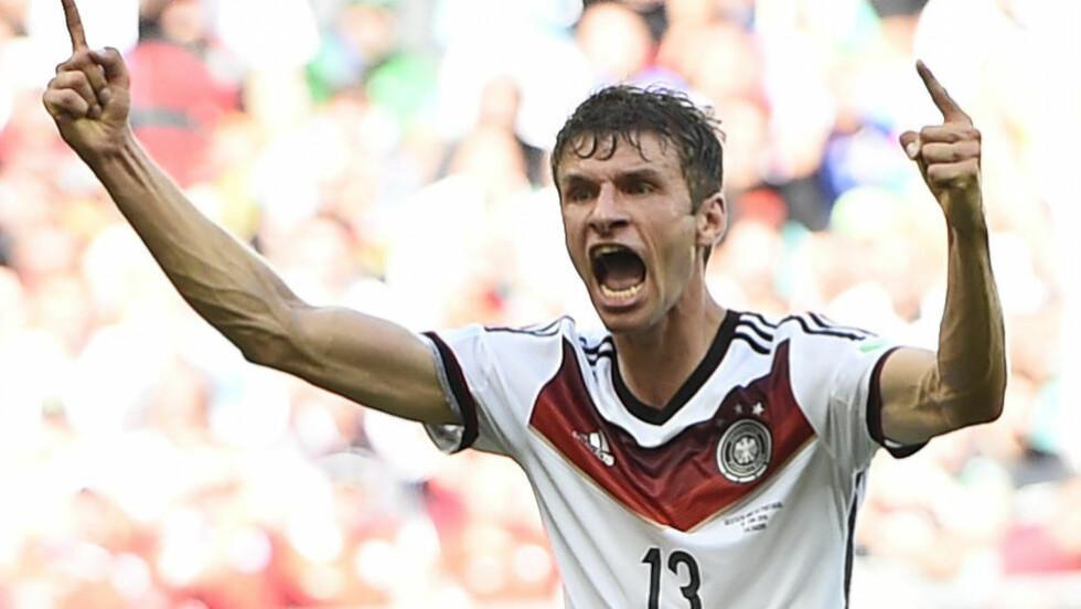 PANGSTART: Thomas Müller scoret det første på straffe - og han fulgte opp med to til etter at Pepe fikk rødt kort. - En perfekt start, sier han til Dagbladet på Arena Fonte Nova.  Foto: Dylan Martinez / Reuters / NTB Scanpix