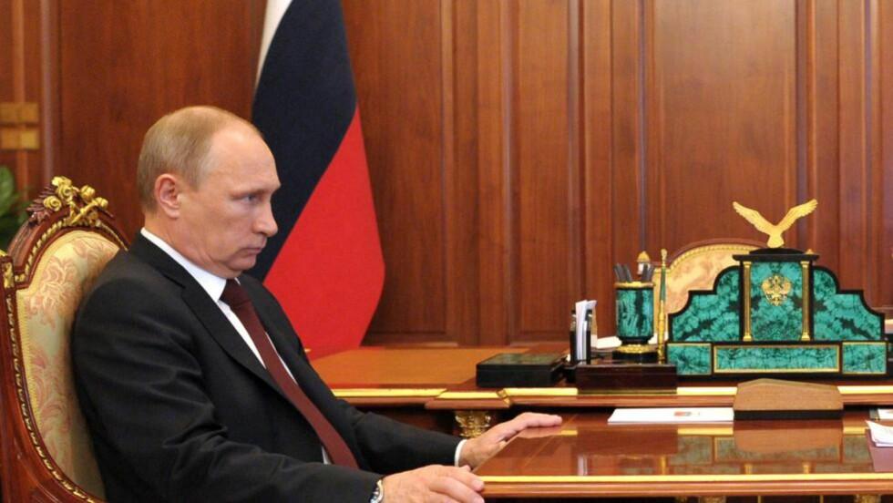 VÅPENHVILE: Russlands preseident Vladimir Putin støtter en våpehvile i Ukraina. Foto: AFP/NTB Scanpix.