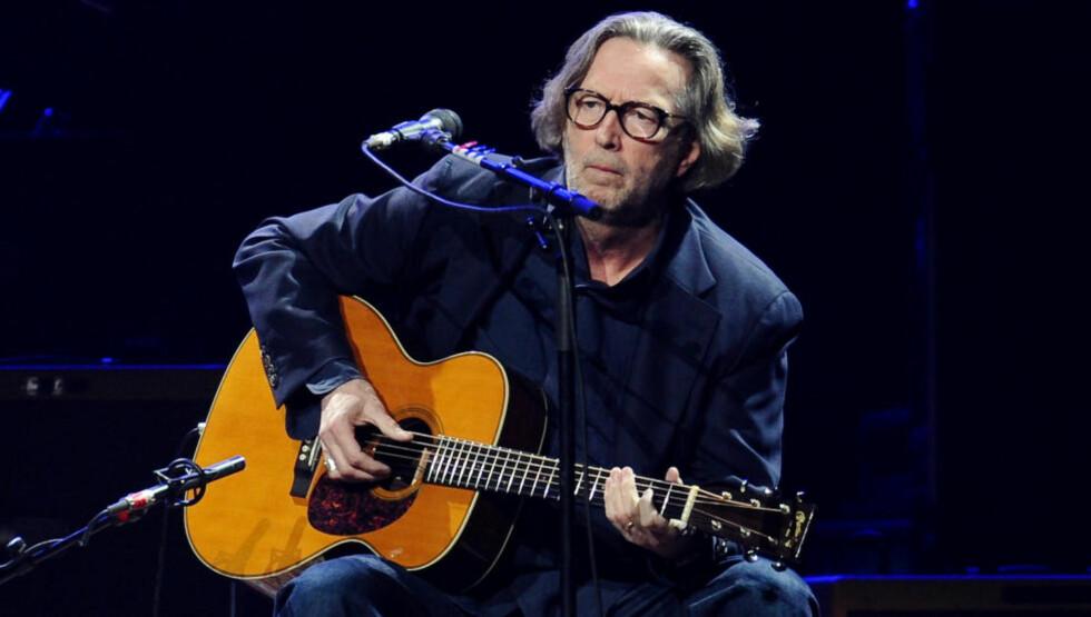 BLE BUET UT: Publikum reagerte med sinne, frustrasjon og buing da Eric Clapton brått avbrøt sin første konsert på tre år før den var ferdig - uten å forklare hvorfor. Foto: AP / NTB scanpix