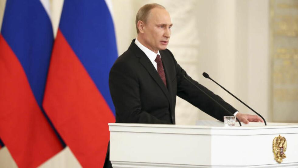 KRAFTFULL :  Russlands president Vladimir Putin leverte en kraftfull seanse da han forsvarte annekteringen av Krim i dag. Foto: REUTERS/Sergei Ilnitsky/Pool