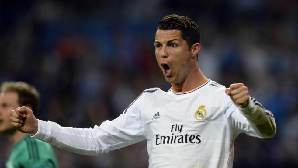 GA MER PENGER I KASSA: Den siste oddskupongen gikk inn takket være seieren til Real Madrid i Champions League-kampen mot Schalke 04 på tirsdag. Cristiano Ronaldo scoret to av målene. Foto: AFP PHOTO / GERARD JULIEN / NTB Scanpix