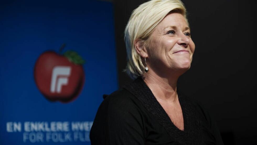 RASER: For over seks år siden sa Siv Jensen at hun var stolt av å lede et populistisk parti. Nå raser hun mot Heikki Holmås som mener Frp er et høyrepopulistisk parti. Stortingsvalget 2013. Foto. Benjamin A. Ward / Dagbladet