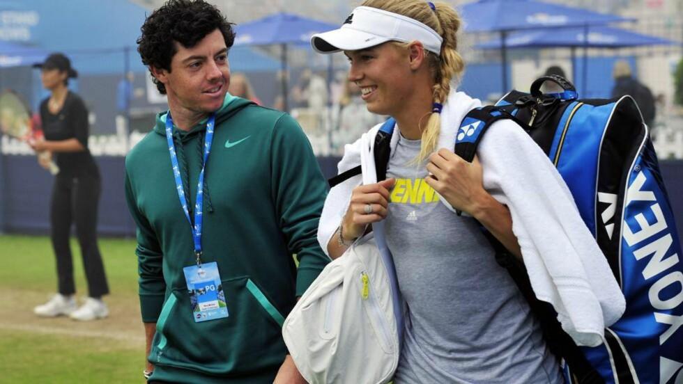 <strong>SAMMEN?:</strong> Golfstjernen Rory McIlroy har vært sammen med tennisspilleren Caroline Wozniacki i to år. Irsk presse er sikre på at paret har gjort det slutt. Foto: AFP PHOTO/GLYN KIRK