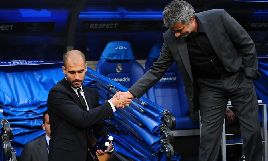 BESTE UVENNER: Det har blitt mange slappe og motvillige håndtrykk mellom Pep Guardiola og José Mourinho etter hvert. Foto: NTB Scanpix/Reuters/SERGIO PEREZ
