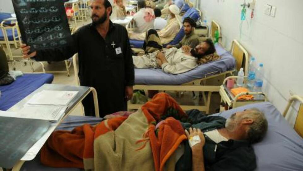 STORT PROBLEM :  ALVORLIG: 1,4 millioner mennesker døde av tuberkulose samme år. Hvert minutt tar tuberkulose livet av tre mennesker i verden, noe som utgjør 4500 dødsfall hver dag, ifølge FN. Dette bildet ble tatt i dag, på verdens tuberkulosedag i Peshawari  Pakistan. Foto: EPA / Arshad Arbab / NTB Scanpix