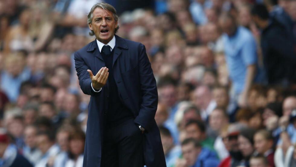TØFF SESONG: Roberto Mancini er forberedt på at det blir vanskelig for Manchester City å forsvare seriegullet fra sist sesong. Foto: REUTERS/Eddie Keogh