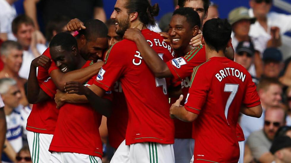 DRØMMESTART: Swansea fikk en drømmestart på sesongen med hele 5-0 mot QPR: Foto: REUTERS/Eddie Keogh