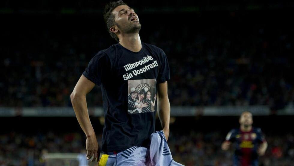 SCORET I COMEBACKET: David Villa har værte ute i åtte måneder med et benbrudd, men i kveld var han tilbake og scoret et vakkert mål. Målet dedikerte han til sin kone og to døtre. Foto: AFP PHOTO/ JOSEP LAGO