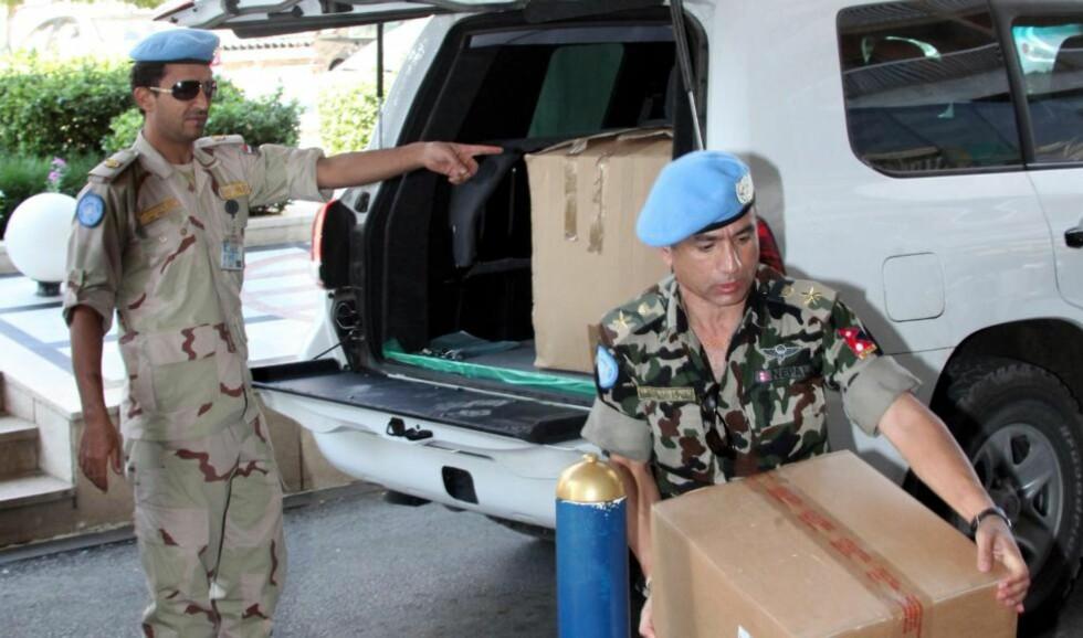 PAKKER OG DRAR: FN-observatørene forlater Syria etter at mandatet deres er over. Foto: EPA / YOUSSEF BADAWI / Scanpix ntb