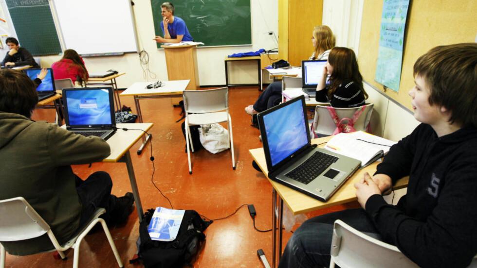 DIGITAL SKOLE: Flere og flere bruker datamaskin på skolen. Dette bildet er fra Flesberg skole, og er ikke relatert til denne spesifikke saken. Foto: Lise Åserud / SCANPIX