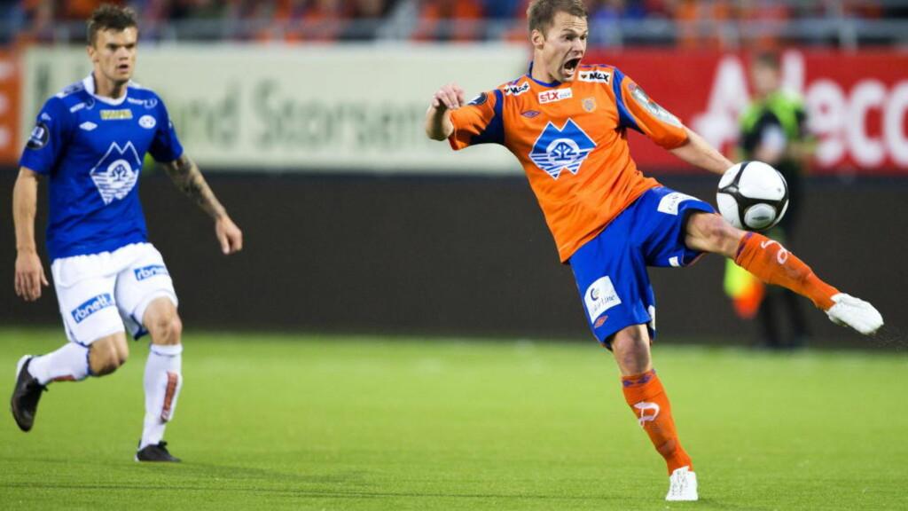 FERDIG: Magnus Sylling Olsen (t.h.), her mot Molde, spiller resten av sesongen i Adeccoligaen. Foto: Svein Ove Ekornesvåg  / NTB scanpix