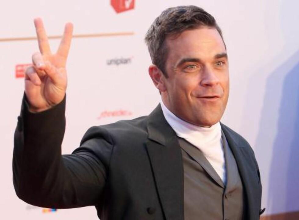 «Candy»: Robbie Williams kommer mot slutten av året med et nytt album. På albumets første singel har han spilt inn store deler av ei låt av norske Todd Terje på nytt. Foto: NTB Scanpix